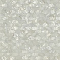 White Rivershell Oval Mosaic Fresh water mother of pearl iridscent creamy white Oval, mounted on ceramic back, mesh mounted on sheets of 11-1/8 x 11-1/2 (.89 sf) interlocking sheets. 18 rows of 9 (164 pcs) per sheet. Also, available unbacked for other types of installations. Dimensions: 11-1/4 X 11-3/8 X 1/8 Product Specifications:      Sold By:Artistic Tile
