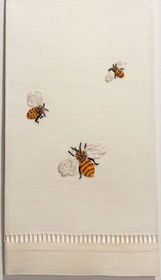 Bee-embroidered linen.