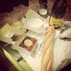 Brie, camembert, baguette, pear and chocolate tart and champagne in the Tuileries Garden
