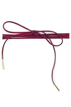 Add a little flair to your outfit with this stylish burgundy wrap choker necklace featuring a faux suede band with two gold metal pole pendants at each end. Wrap it around your neck as many times as y