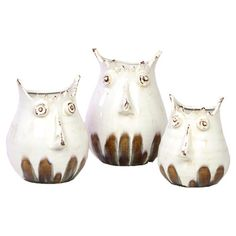 Set of three ceramic vases with abstract owl motifs.Product: Small, medium and large vase   Construction Material: Cer...