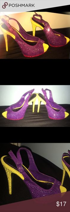 PURPLE, RED & YELLOW RHINESTONE-ENCRUSTED HEELS/7 I am selling a fabulous pair of slingback size 7 Heels. They are purple yellow and red in color and covered in rhinestones! The heel is 5 inches high and I added padding within the soul of the shoe which is a lace pattern in order to make them extra comfortable. Shoes Heels