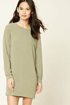A soft knit tunic sweatshirt featuring a round neckline and long sleeves.  Monogram it?