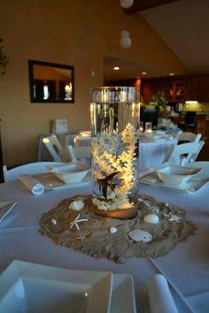 Diy beach themed wedding table center pieces seashells sand tea wedding centerpieces fish beta fish centerpiecebeach theme junglespirit Gallery