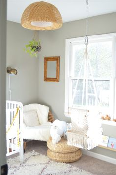 Neutral nursery. Hangahammock baby swing. Macrame. Rattan. IKEA shelves. Jenny Lind crib. White and wooden elements. Baby number two room. Brass eyeball sconce lighting. Hanging plant. Wooden cars. IKEA stools