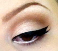 White eyeliner underneath black liquid..love this look