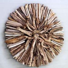 Driftwood Wall Sculpture   This Simple Tutorial on how to Make a Driftwood Wall Sculpture will show you how easy it is to create a stunningly beautiful piece of sculptural art using nothing but weathered driftwood pieces with all its nuances and lovely textures.  This Driftwood Wall hanging brings all the colors and textures into one striking art piece that can be hung indoors or out and in a variety of room decors from beachy to modern.  Supplies Needed:  Heat Gun such as HiPur Former…