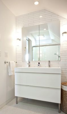Ikea Godmorgon cabinet in gloss white with Braviken sink. Wall sconces from Restoration Hardware. Photo by Andrew Hyslop