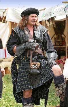 Highlander in a kilt.