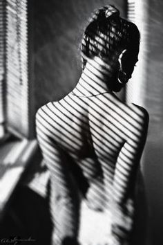 I like this photo because it uses the shadow of hangers to make her back look like it has stripes on it