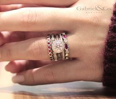 Ring around the rubies! Enhance your engagement ring and wedding band with these simply beautiful white gold, diamond and ruby stackable fashion rings.