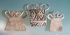 """Hmong and Thai Spirit locks.  These pendants are believed to """"lock"""" the wearer's soul into the body during ritual ceremonies."""