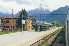 Colico, Italy by Hanna Taylor - facing the Italian Alps... Lombardy region - train station wanderlusttour.com