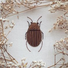 Embroidery artist Humayrah Bint Altaf stitches fabulously ornate insects and trees that incorporate antique gold twist cord, hundreds of metallic beads, Rococo threads, and other delicate materials…