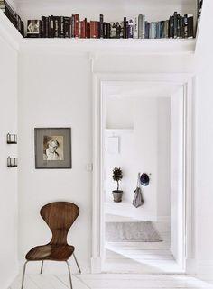 white walls with open bookshelves above. / sfgirlbybay