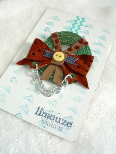 Leather Bow  Woven Abstract Moth  Wreath Brooch  Eyelet by limouze