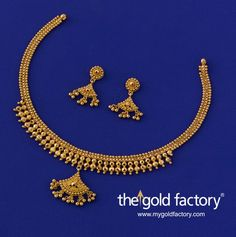 Small chhela half-spheres formally arranged to form an apron front and a swinging wire-ball pendant give this necklace a clean, ordered character with a nicely-turned-out traditional look. With matched earrings, a lightweight set handmade in hallmarked 22K gold.