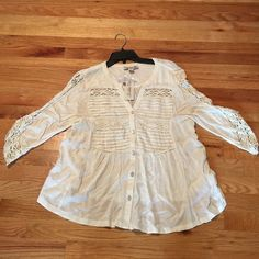 NWT, Vintage America by Lucky Cream Lace Top New with tags, all Viscosa/ Cotton material. Very cute lacy detail on arms and chest line. Three quarter sleeve, cream color, buttons but a flow top at bottom Vintage America Tops Blouses