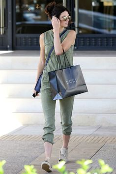 Kendall Jenner wearing Chanel Lace Up Espadrilles, Celine Smooth Leather Nano Luggage Navy, Linda Farrow 307 Sunglasses in Rose Gold and Joie Cargo Sleeveless Jumpsuit in Olive/Army