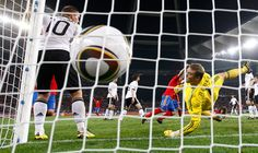 Carles Puyol scores past Germany's goalkeeper Manuel Neuer during the 2010 World Cup semi-final at Moses Mabhida stadium in Durban July 7, 2010. (REUTERS/Eddie Keogh)