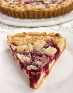A buttery crust, sweet cheesecake, tart cranberries, and a crumb topping make this Cranberry Cheesecake Pie irresistible! - Bake or Break