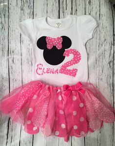 ***Leave a note during checkout with your headband choice and if you want elastic or a clip***This Minnie Mouse inspired birthday outfit is perfect for your themed party! It can come with the number 1, 2 or 3 and can also be done in red! The outfit comes with a bodysuit or shirt, fabric and tulle tutu and custom headband. If youd like to make any changes send me a message and we can create something together! If you are purchasing just the shirt I will refund the shipping overage, as it will…