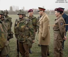 King George VI inspects British 1st Airborne troops in training, 16th of March 1944.  To the King's left wearing the Pegasus patch is Brigadier John 'Shan' Hackett, 4th Parachute Brigade and to the King's right is Lt. Col. Kenneth Smyth, 10th Parachute Battalion.