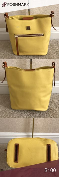 "Dooney & Bourke Raleigh Roxy Bag Preown.has a small pen mark infront of purse next to that has a small spot of chipping of the leather. A few wrinkle spots in the back bottom right corner.Measures approximately 10""W x 10-1/2""H x 5-3/4""D with a 17"" to 23"" strap drop; weighs approximately 2 lbs, 2 oz Body/trim 100% leather; lining 100% cotton Dooney & Bourke Bags Crossbody Bags"