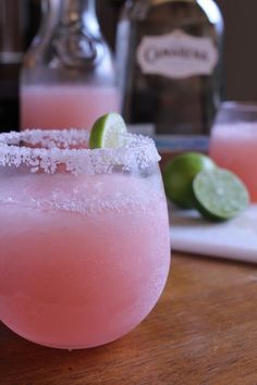 Pink Lemonade Margarita - frozen pink lemonade concentrate, tequila, Grand Marnier, crushed ice, salt to rim the glass, lime wedge