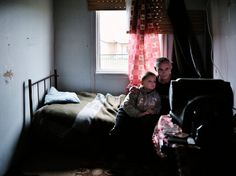Christopher Anderson SERBIA. 2008. A refugee camp for Serbs displaced by fighting or threats from their villages. They live in containers suppied by Russia. Here, Peric RADOVAN from Paralovo village watches television with his neighbor George JOVANIC.