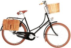 Gorgeous female cruiser bike prepped with basket and saddle bags.