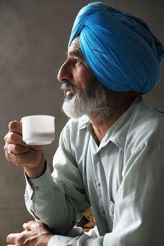 sikh gentleman, wearing his turban and enjoying tea