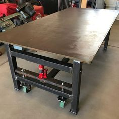 """Throwback to the 1000 lb + table build in 2017. 3/4"""" top, adjustable feet and jacks to raise around and move with the push of a finger. #workbench"""