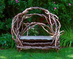 Bittersweet garden bench. This dramatic garden bench makes quite a statement. It's seat is hewn from natural cleft bluestone.