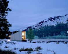 Surrounded by the serenity of the evergreen forest and snow-capped mountains of its Winthrop, Washington location, the rustic Methow Cabin designed by Eggl