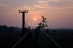 Electrical Sunset - The sunset in Nanjanjud, India with an electrical pole in the foreground.