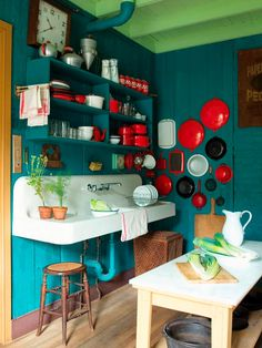 "Vintage Kitchen Wall Art!  I also love the color combos of ""lagoon blue,"" red, and white, with the unexpected pop of mint on the ceiling....Gorgeous Room!!!!"