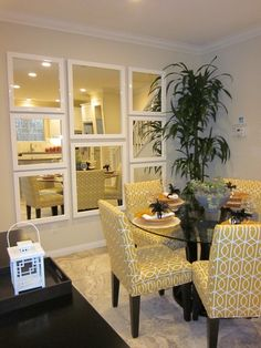 no window? try a mirror collage to open up a room. also I love those mustard yellow chairs. SEPARATE FRAMES DOESN'T MAKE SPACE SEEM LARGER