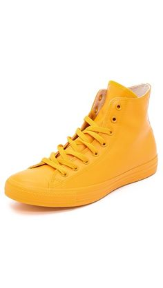 Rubber coated bright yellow Converse sneakers
