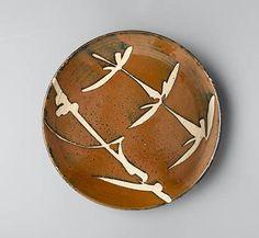 "Shoji Hamada  |  Round stoneware dish, persimmon glaze with wax-resist flower stem and bamboo designs (dia:11 1/2"")."