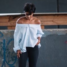 Light Denim Off Shoulder Top S M L Light denim off shoulder button down top. Can be worn slightly off the shoulder or around the chest with sleeves tied in front. Please note cover photo style was achieved by wearing a much larger size. 100% Cotton. If interested let me know so I can make separate listing. Tops Button Down Shirts