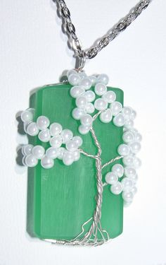 Wire Wrapped White Tree of Life over Green Acrylic Rectangle Bead. $20.00, via Etsy.