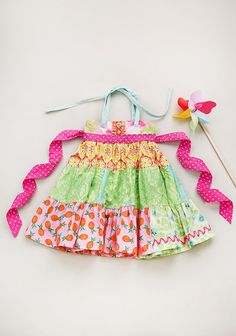 Summer's Not Over Tiered Ellie Dress $68.00 Item #: P15GD81 Born with love in the USA.