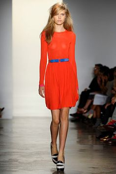 Peter Som Spring 2012 collection. Bright tangerine long sleeve jewel neck short dress belted with cobalt blue. Always been a fan of this color combination. Cool!