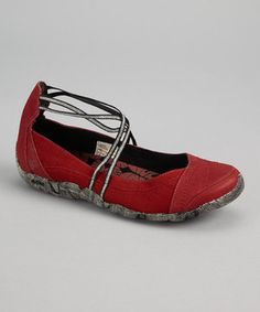 There's zero shame in a great-looking casual shoe with a hint of femininity. This pair of sweet suede-and-canvas flats provides a cushy, comfortable way to go about the day with a breathable lining and a molded EVA footbed for added cushion.