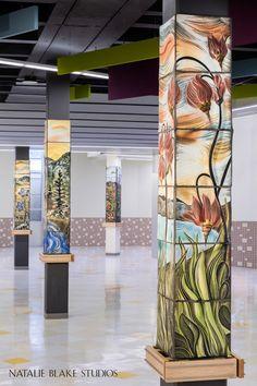 Natalie Blake Studios ceramic tiles adorn the columns in this Alaskan high school cafeteria in Anchorage. Ten columns were covered with ten wild flower murals in their native habitat.