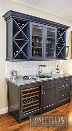 This custom wet-bar hutch includes a wine fridge. The wet-bar utilizes new materials and finishes such as a cold cast zinc countertop with a glass under-mount sink. Wine Home Decor Ideas Wet Bar Basement, Basement Bar Designs, Home Bar Designs, Wet Bar Designs, Basement Finishing, Basement Kitchenette, Basement Ideas, Home Wet Bar, Bars For Home
