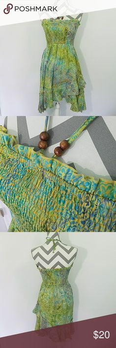 """Halter Dress Beautiful halter dress perfect for summer! Wore twice. No stains or tears. Dress measures 29"""" at longest point. Excellent condition! Dresses"""