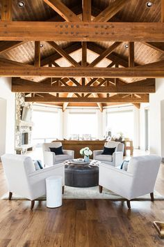 Round ottoman Park City Canyons Remodel: Great Room, Dining, Kitchen — STUDIO MCGEE
