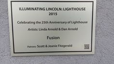 Illuminating Lincoln: Lighthouse art project.  Lightbulb titled: Fusion located at Lincoln Journal Star Printing Center 10th and Q street Lincoln, Ne.  Artists:  Linda Arnold and Dan Arnold.  Sponsored by:  Scott and Jeanie Fitzgerald